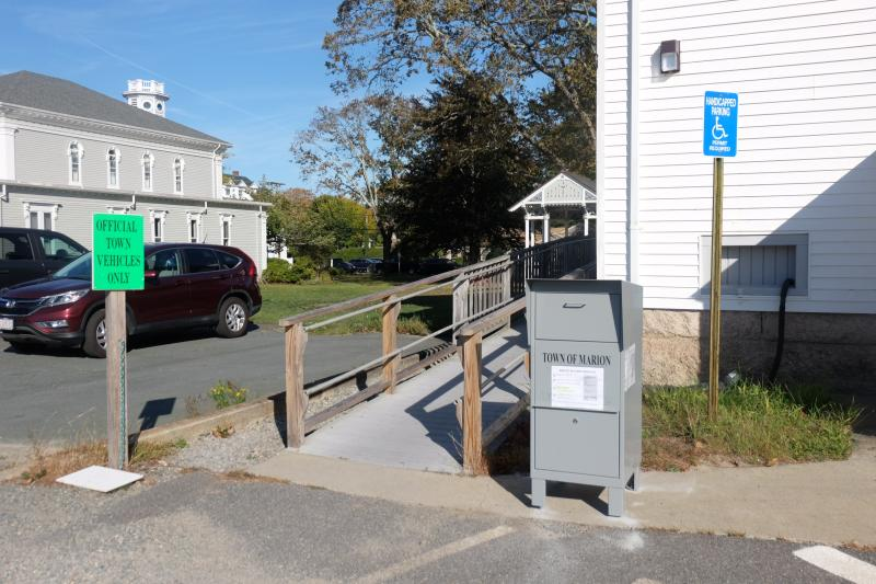 Marion's drop box is located at the bottom of the handicap ramp at the back of the Town House, closest to the library.